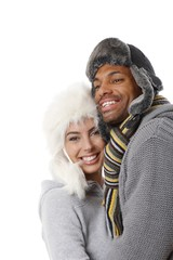 Interracial couple embracing at winter