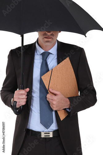 Businessman under an umbrella