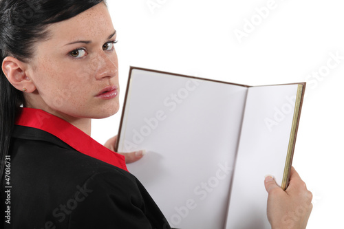 businesswoman holding a book