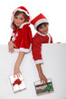 Children dressed as Santa Claus