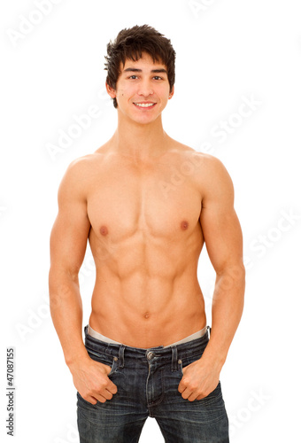 Smiling handsome young man with muscular and tanned naked torso.