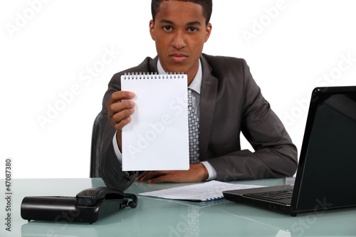 Businessman with a blank notebook