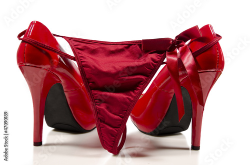 Leinwandbild Motiv Red high heels and g-string