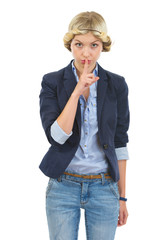 Teenage girl showing shh gesture
