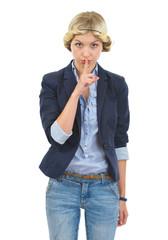 Teenage girl showing shh gesture