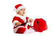 Small Santa with red bag for gifts near him