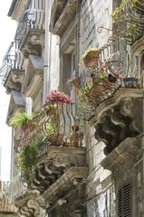 europe, italy, sicily, siracusa, baroque balconies in ortgiai