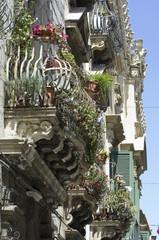europe, italy, sicily, siracusa, baroque balcony in ortigia