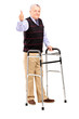 Mature gentleman using a walker and giving a thumb up