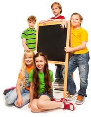 Five kids with blackboard
