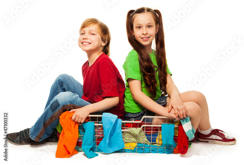 two kids in clothing basket
