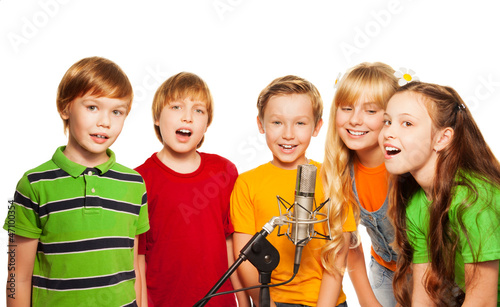 Group of 8 years old kids with microphone