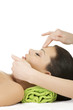 Beautiful relaxed woman enjoy receiving face massage