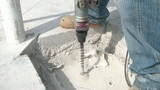 Drilling Hole into Concrete at Construction Site