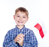 A little boy with  Polish flag on the white background