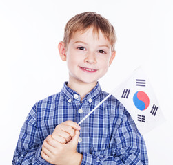 A little boy with south koreanian flag on the white background