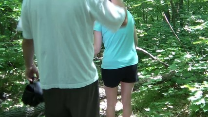 Family Hiking in Woods Together