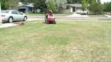 Father & Son on Riding Lawn Mower
