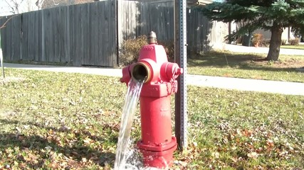 Red Fire Hydrant Pouring Water