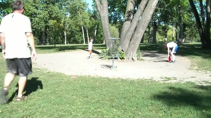 Family Playing Frisbee Golf Together