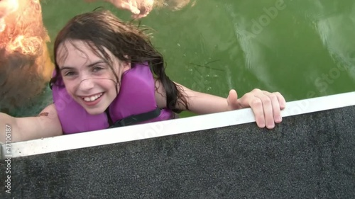 Girl Smiling Tries to Get Into Boat