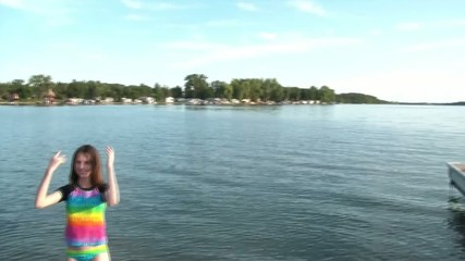 Girl Waves In Lake to Swim