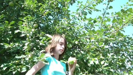 Girl Picks Apple from Tree & Eats It