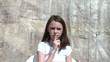 Girl Using Shush Over Mouth Gesture
