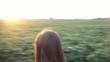 Girl Walking Dog at Sunset