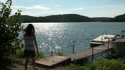Girl Walking to Lake in Morning
