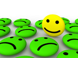 Happy smiley face among sad smileys