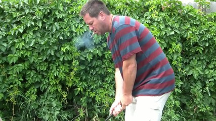 Man Golfing with Cigar in Mouth