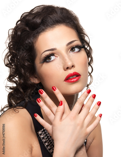 Beautiful fashion woman with red manicure and lips
