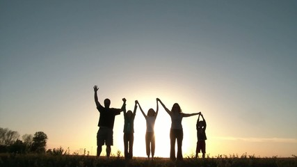 People Raising Arms Together at Sunset
