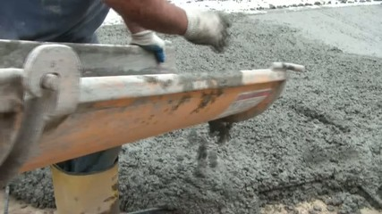 Wet Cement Flowing from Chute on Truck