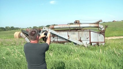 Man Taking Pictures on Farm
