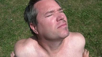 Half Shaven Man Suntanning