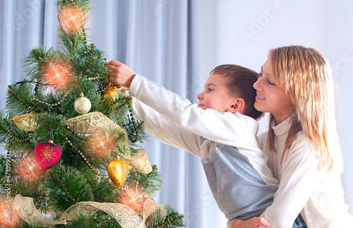 Kids Decorating Christmas Tree. Happy Children