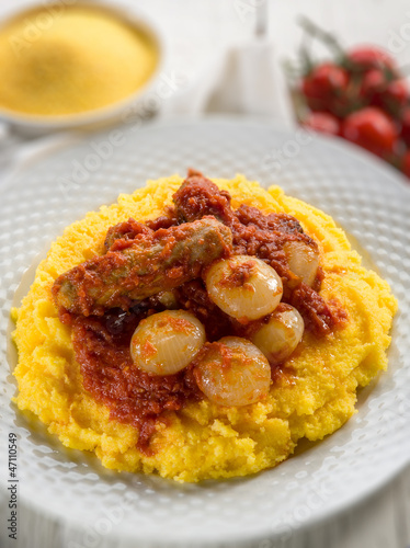 porridge with sausage and tomatoes sauce, selective focus