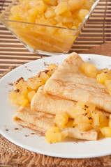 Sweet crepes with apple caramel and cream