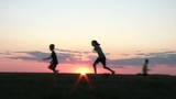 Kids Playing Tag at Sunset