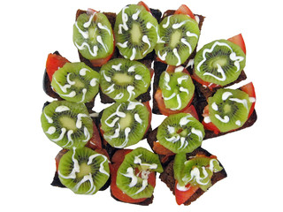 slice of bread and kiwi and tomatoes with mayonnaise