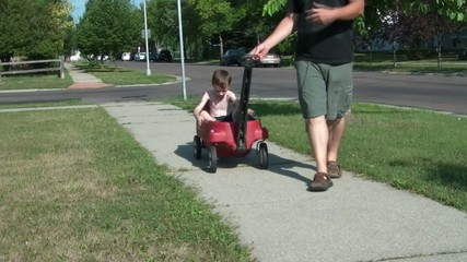 Dad Pulling Son in Wagon