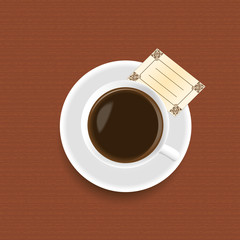 A cup of coffee with a card