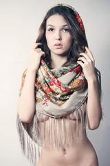 beautiful naked girl in a beautiful scarf