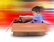 Boy Speed Driving in Box Car
