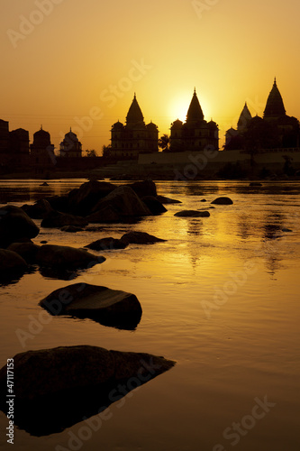 Sunset silhouette of Chhatris by the river in Orchha