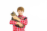 boy with his cat in the arm