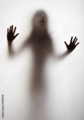 a girl silhouette behind a  transparent  paper background