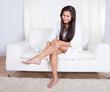 Woman admiring her bare legs